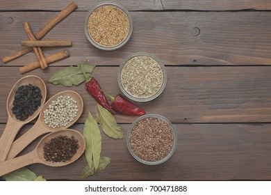 Wooden spoons with spices on wooden boards
