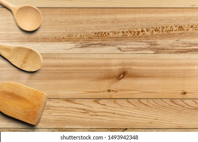 Wooden spoons and stirrer on wooden table. Kitchen and Cooking Concept.