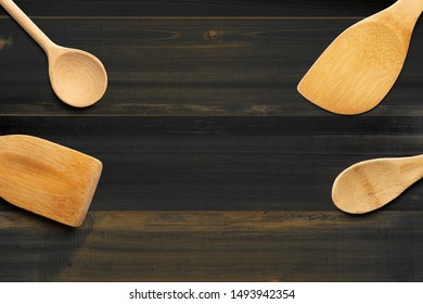 Wooden spoons and stirrers on wooden table. Kitchen and Cooking Concept.