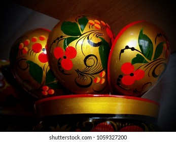 Wooden Spoons and tableware. Closeup. Khokhloma - an ancient Russian folk craft (XVII century). Traditional elements Khokhloma - red juicy berries of mountain ash and wild strawberries