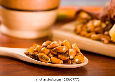 Wooden spoons with toasted corn grains, known as tostado in south america,
