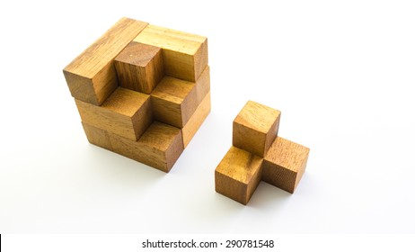 Wooden square block cube puzzle. Isolated on white background. Concept of complex and smart logical thinking. Slightly defocused and close up shot. Copy space.