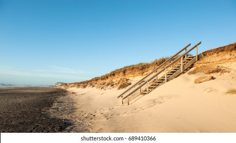 A wooden stair to the beach in Denmark