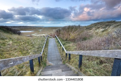 wooden stair path to marshes, Texel, Netherlands