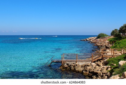 A wooden staircase in the azure sea. Limassol. Cyprus.