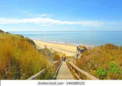 Wooden staircase at the Cliff of Asperillo in Cuesta Maneli beach, very close to the famous Doñana National Park and Mazagón in the province of Huelva, Andalusia, Spain
