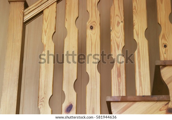 A wooden staircase closeup. Tree. Texture. Background.