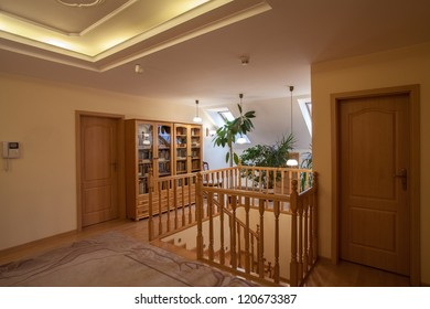 Wooden staircase and corridor on the attic