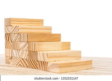 Wooden staircase in front of white background as a symbol of rocky ascent