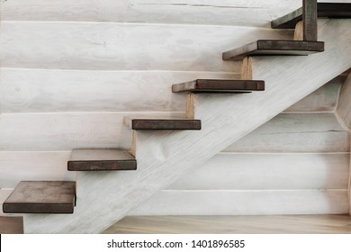 wooden staircase with a wooden log in the house