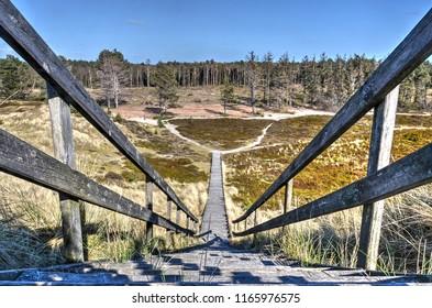Wooden staircase and plankbridge in the dunes on the German Northsea island of Amrum
