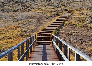 Wooden stairs to the beach. Personal development and growth concept.