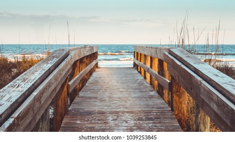 Wooden stairs to the beach with waves