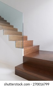 wooden stairs detail with hardened glass balustrade