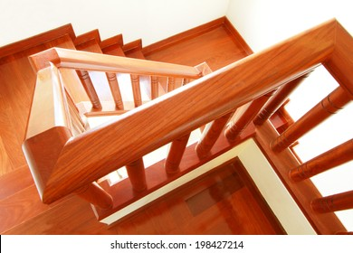 Wooden stairs and handrail