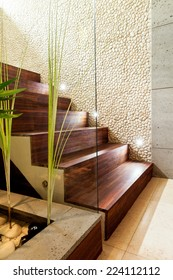 Wooden stairs in luxury and modern apartment