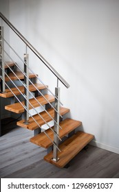 Wooden stairs and metal handrail