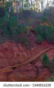 Wooden stairs on Le Sentier des Ocres in Roussillon - France vertical