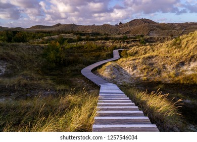 Wooden stairs of a path through the island of Amrum in Germany.