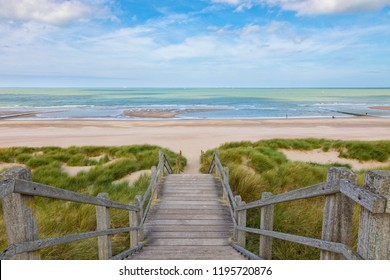 Wooden stairs through the dunes down to the North Sea beach at Blankenberge, Belgium