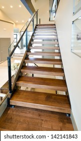 Wooden stairs to the upper level. Interior design. Vertical.