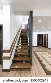 Wooden stairway in the house interior with stair light