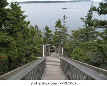 wooden stairway to ocean from mountain