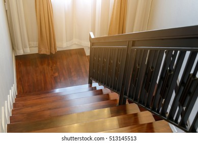wooden stairway with wooden railing in model home
