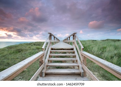 wooden stairway threw dune landscape on the island