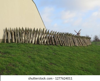 Wooden stake fortification against grey winter clouds in Southern Denmark, site of 1864 war with Germany