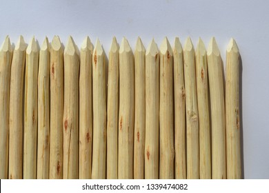 Wooden stakes on a white background.