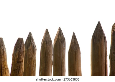 wooden stakes or wall made from wooden logs, isolated on white.