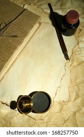 Wooden stamp, book and old papers, close up