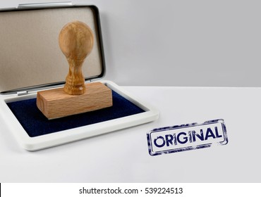 Wooden stamp on a desk ORIGINAL