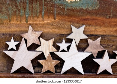 Wooden stars lie on a wooden table