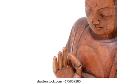 Wooden statue of buddha isolated on white background