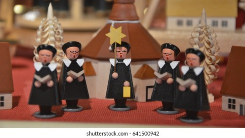 Wooden statue carolers seen in storefront in Oberammergau Germany
