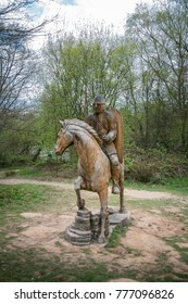 A wooden statue of a soldier astride his horse on the battlefield, Battle Abbey, Sussex, UK, April 13th 2017