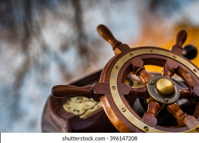 Wooden steering wheel on an old ship