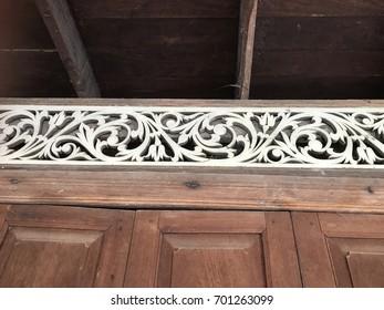 Wooden stencil over the door.