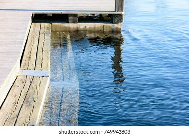Wooden steps into the water for easy access when bathing.