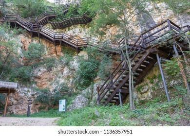 Wooden steps leading to Ozidana Cave near Roski Slap Waterfalls, Krka National Park, Croatia