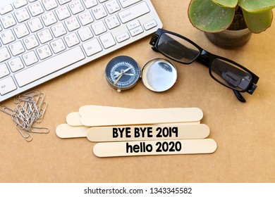 wooden stick with  bye bye 2019 hello 2020, new year concept