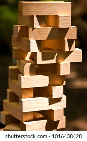 Wooden sticks game called jenga in sun rays