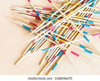 wooden sticks of Mikado pick-up sticks game close up on table
