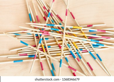 wooden sticks of Mikado pick-up sticks game close up on wood board