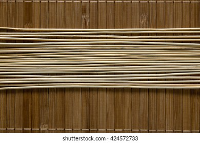 Wooden sticks on a wooden background