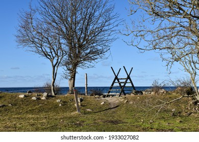 Wooden stile by a coastal footpath on the island of Oland in Sweden