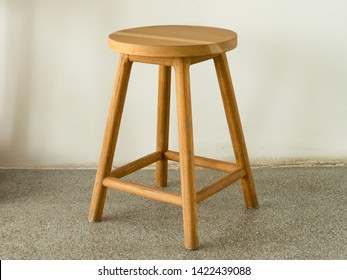 Wooden stool in natural color and simple design.