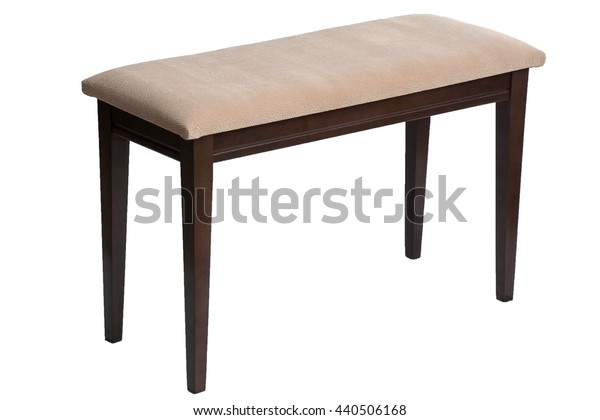 wooden stool with padded seat on a white background. Bench with upholstered seat.